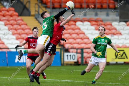 Stock Image of Down vs Meath. Down's Patrick Murdock competes in the air with Jordan Morris of Meath