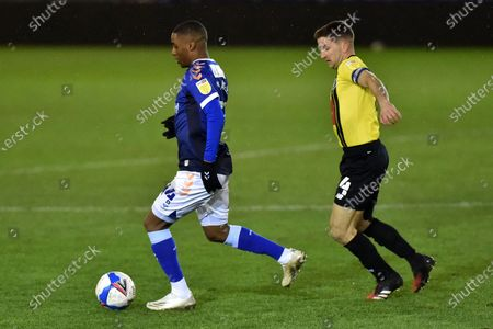 Oldham Athletic's Dylan Fage tussles with Josh Falkingham of Harrogate Town FC during the Sky Bet League 2 match between Newport County and Oldham Athletic at Rodney Parade, Newport on Saturday 19th December 2020.