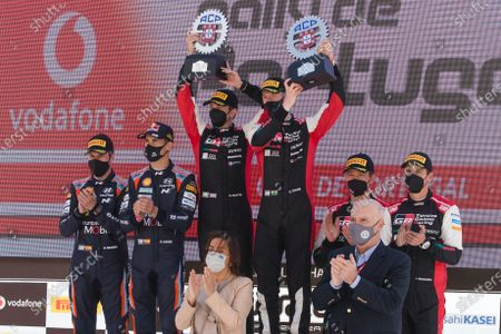 Elfyn Evans (3-R) of Britain of Toyota Yaris WRC and his co-driver Scott Martin (3-L) celebrate after winning the Rally Portugal 2021 as part of the FIA World Rally Championship (WRC) in Matosinhos, Portugal, 23 May 2021. Evans won ahead of second placed Dani Sordo (2-L) of Spain, and third placed Sebastien Ogier (2-R) of France.