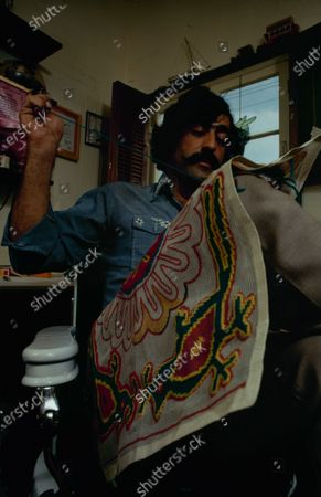 Cartoonist Sergio Aragones in his home working on a brightly colored needlepoint, March 1971.