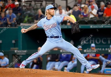 Texas Rangers starting pitcher Mike Foltynewicz throws to the plate against the Houston Astros during the first inning a baseball game in Arlington, Texas