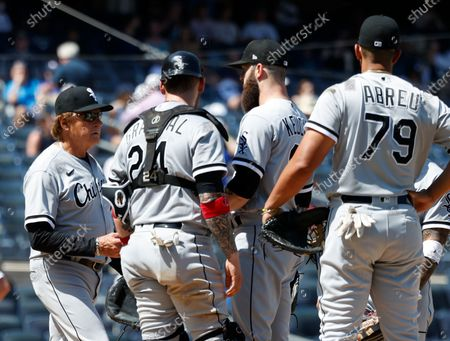 Chicago White Sox manager Tony La Russa (L) is seen taking out Chicago White Sox starting pitcher Dallas Keuchel (C-L) during a pitching change against the New York Yankees in the top of the fifth inning of their MLB game in the Bronx, New York, USA, 23 May 2021.