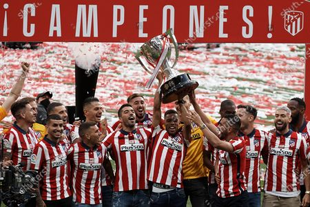 Renan Lodi of Atletico Madrid lifts the trophy during the presentation ceremony of the La Liga 20/21 championship trophy at Estadio Wanda Metropolitano on May 23, 2021 in Madrid, Spain.
