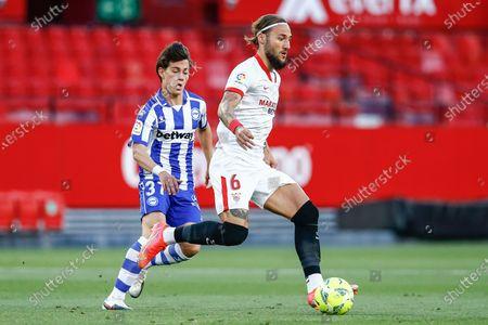 Stock Photo of Facundo Pellistri of Deportivo Alaves and Nemanja Gudelj of Sevilla FC