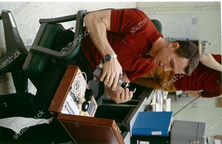 Astronaut David Randolph Scott holding an equipment, Cape Canaveral, Florida, 1969.