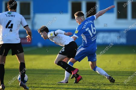 Barrows Thomas Beadling challenges Salfords Luke Burgess during the Sky Bet League 2 match between Barrow and Salford City at the Holker Street, Barrow-in-Furness on Saturday 5th December 2020.