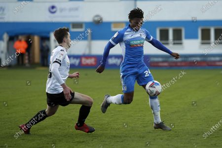 Barrows Kgosietsile Ntlhe bring the ball passed Luke Burgess of Salford during the Sky Bet League 2 match between Barrow and Salford City at the Holker Street, Barrow-in-Furness on Saturday 5th December 2020.