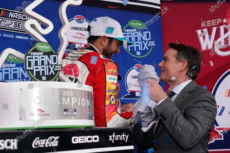 Chase Elliott, left, is greater by former NASCAR champion Jeff Gordon, right, in Victory Lane after winning the NASCAR Cup Series auto race at the Circuit of the Americas in Austin, Texas