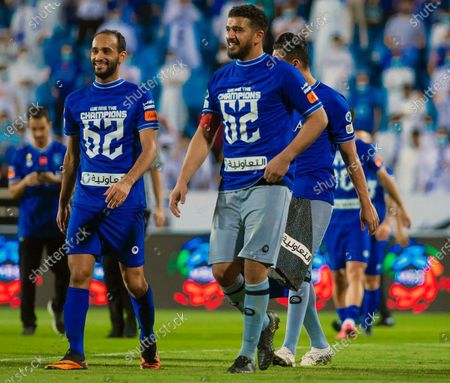 Al-Hilal's players Abdullah Ateef (L) and Abdullah Al-Mayouf (R) celebrate winning the Saudi Professional league after the soccer match between Al-Taawoun and Al-Hilal that ended (0-1) at King Abdullah Sports City Stadium, in Buraidah, Saudi Arabia, 23 May 2021.
