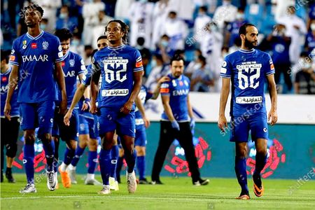 Al-Hilal's players Mohamed Kanno (L), Andre Carrillo (C) and Abdullah Ateef (R) celebrate winning the Saudi Professional league after the soccer match between Al-Taawoun and Al-Hilal that ended (0-1) at King Abdullah Sports City Stadium, in Buraidah, Saudi Arabia, 23 May 2021.
