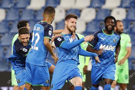 Sassuolo's  Giorgos Kyriakopoulos (C) jubilates with his teammates after scoring a goal during the Italian Serie A soccer match US Sassuolo vs SS Lazio at Mapei Stadium in Reggio Emilia, Italy, 23 May 2021.