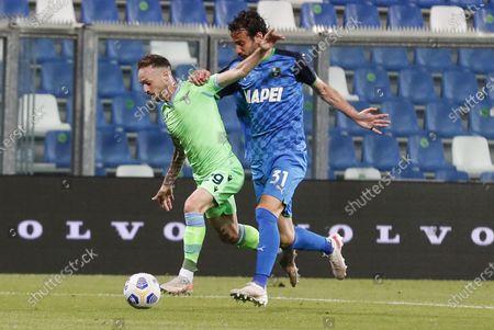 Sassuolo's Gian Marco Ferrari (R) and Lazio's Manuel Lazzari (L) in action during the Italian Serie A soccer match US Sassuolo vs SS Lazio at Mapei Stadium in Reggio Emilia, Italy, 23 May 2021.