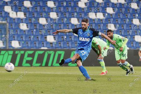 Sassuolo's Domenico Berardi scores the 2-0 goal during the Italian Serie A soccer match US Sassuolo vs SS Lazio at Mapei Stadium in Reggio Emilia, Italy, 23 May 2021.