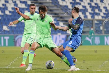 Lazio's Marco Parolo (L) fouls Sassuolo's  Francesco Caputo in the penalty box during the Italian Serie A soccer match US Sassuolo vs SS Lazio at Mapei Stadium in Reggio Emilia, Italy, 23 May 2021.