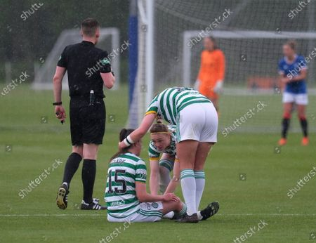 Stock Image of Kelly Clark of Celtic had to go off injured during the Scottish Womenâ€s Premier League 1 match between Rangers and Celtic at Rangers Training Centre in Glasgow, Scotland.