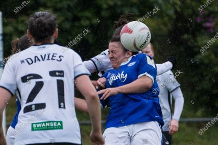Catherine Walsh (19 Cardiff) heads the ball during the Welsh Premier Womens Football League game between Swansea City and Cardiff at Llandarcy Academy in Neath, Wales.