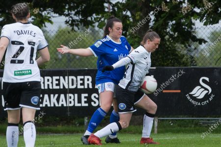 Tija Richardson (22 Swansea) controls the ball as Catherine Walsh (19 Cardiff) applies pressure during the Welsh Premier Womens Football League game between Swansea City and Cardiff at Llandarcy Academy in Neath, Wales.