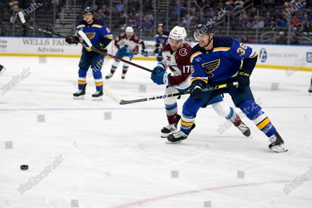 St. Louis Blues' Steven Santini (36) and Colorado Avalanche's Tyson Jost (17) chase after a loose puck during the first period in Game 4 of an NHL hockey Stanley Cup first-round playoff series, in St. Louis