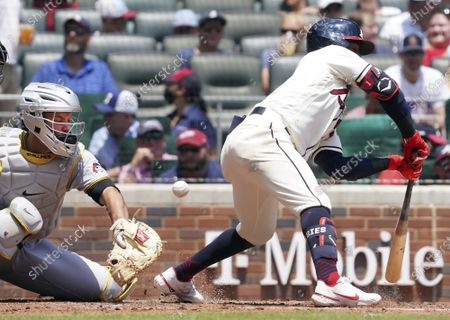 Stock Picture of Atlanta Braves' batter Ozzie Albies, right, is hit by a pitch in the foot as Pittsburgh Pirates catcher Jacob Stallings looks on in the third inning of an baseball game, in Atlanta. The Braves' defeated the Pirates' 7-1