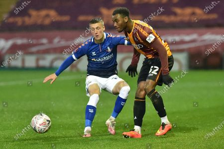 Oldham Athletic's Jordan Barnett tussles with Bradford City's Dylan Mottley-Henry during the FA Cup match between Bradford City and Oldham Athletic at the Coral Windows Stadium, Bradford on Saturday 28th November 2020.