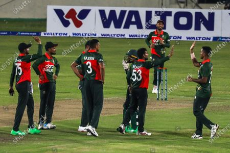 Bangladesh's Mehidy Hasan Miraz (C) celebrates with team mates after taking the wicket of Sri Lanka's Ashen Bandara (not pictured) during the first one-day international (ODI) cricket match between Bangladesh and Sri Lanka at the Sher-e-Bangla National Cricket Stadium in Dhaka on May 23, 2021.