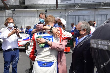 Stock Photo of Mick Schumacher (DEU #47), Haas F1 Team welcomes and embraces FIA President Jean Todt with his wife Michelle Yeoh on the Monaco grid.