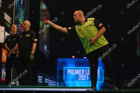 Michael van Gerwen in action against Gary Anderson; Marshall Arena, Milton Keynes, Buckinghamshire, England; Professional Darts Corporation, Unibet Premier League Night 14 Milton Keynes.