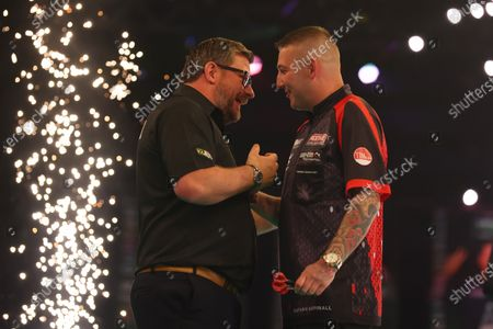 James Wade shakes hands with Nathan Aspinall after drawing the match 7-7; Marshall Arena, Milton Keynes, Buckinghamshire, England; Professional Darts Corporation, Unibet Premier League Night 14 Milton Keynes.