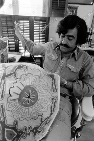 Cartoonist Sergio Aragones in his home working on a needlepoint project, March 1971.