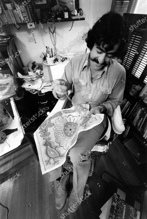 Stock Picture of Cartoonist Sergio Aragones in his home working on a needlepoint project, March 1971.