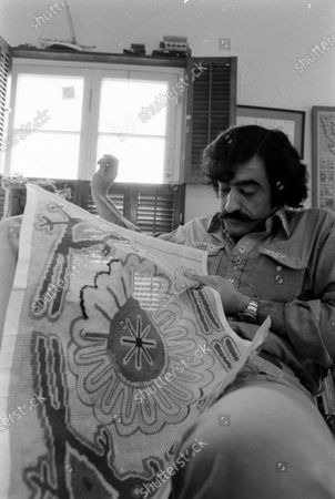 Stock Image of Cartoonist Sergio Aragones in his home working on a needlepoint project, March 1971.