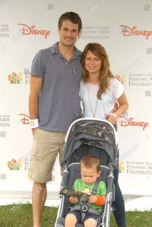 Stock Picture of Mary Lynn Rajskub (R) husband Matthew Rolph (L) and son Valentine Anthony Rolph