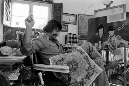 Stock Photo of Sergio Aragones Domenech working on a needlepoint project in his home, Ojai, California, March 1971.