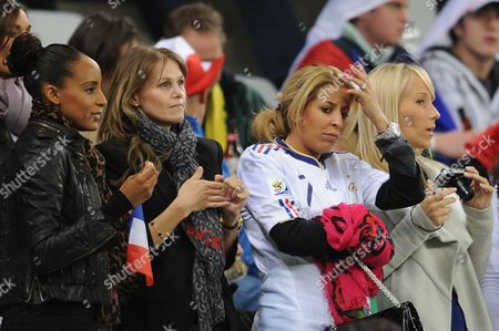 Stock Photo of The wife of France's striker Djibril Cisse, Jude (2nd left), Wahiba Ribery (2nd right), Barbara Anelka (right) and their friends