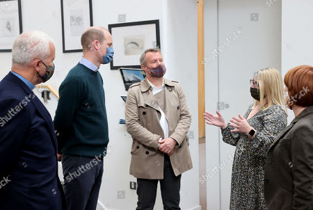CEO Jonny Kinross (R) and Founder and Greyfriars Kirk minister, Richard Frazer (C) with Prince William (2nd R) as he visits the Grassmarket Community Project, a social enterprise set up by Greyfriars Kirk (Church of Scotland) on May 23, 2021 in Edinburgh, Scotland.