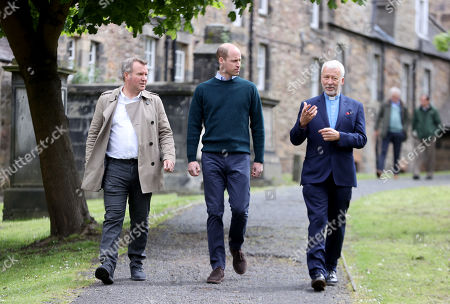 CEO Jonny Kinross (L) and Founder and Greyfriars Kirk minister, Richard Frazer (R) with Prince William (C) as he visits the Grassmarket Community Project, a social enterprise set up by Greyfriars Kirk (Church of Scotland) on May 23, 2021 in Edinburgh, Scotland.