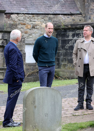 CEO Jonny Kinross (R) and Founder and Greyfriars Kirk minister, Richard Frazer (L) with Prince William (C) as he visits the Grassmarket Community Project, a social enterprise set up by Greyfriars Kirk (Church of Scotland) on May 23, 2021 in Edinburgh, Scotland.