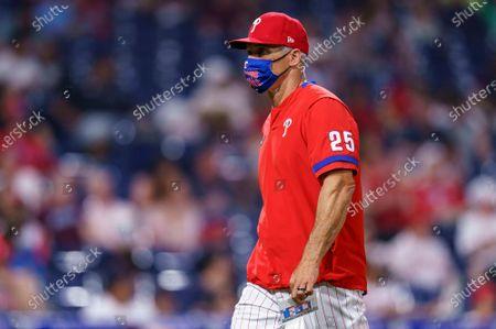 Philadelphia Phillies manager Joe Girardi looks on during the fourth inning of a baseball game against the Boston Red Sox, in Philadelphia