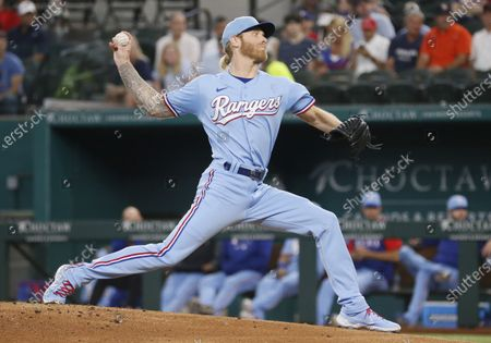 Texas Rangers starting pitcher Mike Foltynewicz throws to the plate against the Houston Astros during the first inning of a baseball game in Arlington, Texas