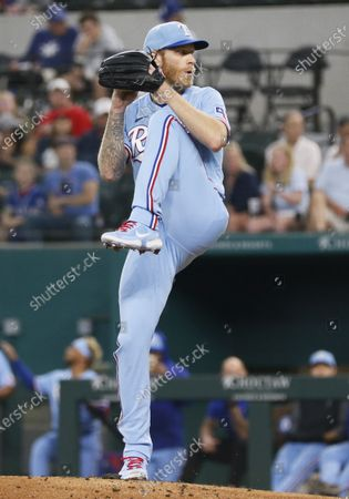 Texas Rangers starting pitcher Mike Foltynewicz goes into the windup against the Houston Astros during the first inning of a baseball game in Arlington, Texas