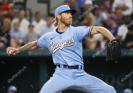 Texas Rangers starting pitcher Mike Foltynewicz throws to the plate against the Houston Astros during a baseball game in Arlington, Texas
