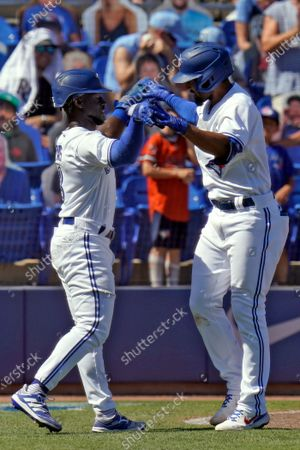 Stock Picture of Toronto Blue Jays' Marcus Semien, right, celebrates with Jonathan Davis after Semien hit a two-run homerun off Tampa Bay Rays relief pitcher Jeffrey Springs during the 10th inning of a baseball game, in Dunedin, Fla