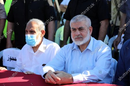 Senior Hamas leaders, Rouhi Mushtaha and Mahmoud Al-Zahar attend a rally in Gaza City on May 24, 2021. A ceasefire was reached late last week after 11 days of deadly violence between Israel and the Hamas movement which runs Gaza, stopping Israel's devastating bombardment on the overcrowded Palestinian coastal enclave which, according to the Gaza health ministry, killed 248 Palestinians, including 66 children, and wounded more than 1,900 people. Meanwhile, rockets from Gaza claimed 12 lives in Israel.