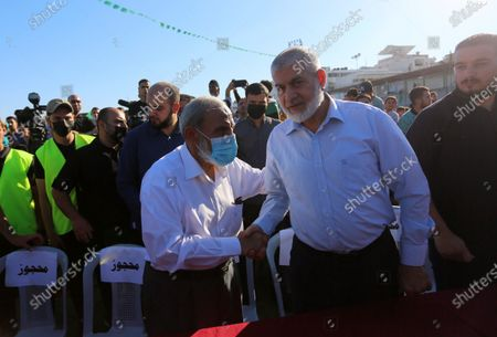 Stock Photo of Senior Hamas leaders, Rouhi Mushtaha and Mahmoud Al-Zahar attend a rally in Gaza City on May 24, 2021. A ceasefire was reached late last week after 11 days of deadly violence between Israel and the Hamas movement which runs Gaza, stopping Israel's devastating bombardment on the overcrowded Palestinian coastal enclave which, according to the Gaza health ministry, killed 248 Palestinians, including 66 children, and wounded more than 1,900 people. Meanwhile, rockets from Gaza claimed 12 lives in Israel.