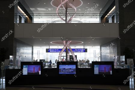 Stock Image of Chandelier hangs behind interactive kiosks at the new West Gates at Tom Bradley International Terminal at Los Angeles International Airport, in Los Angeles