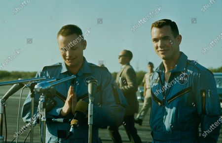 Neil Armstrong (L) David Randolph Scott (R) standing to the microphones, Cape Canaveral, Florida, United States, circa 1966.
