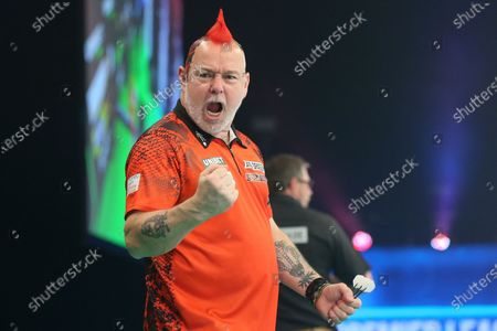 Peter Wright beats James Wade and celebrates during the PDC Unibet Premier League darts at Marshall Arena, Milton Keynes