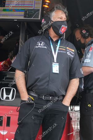 Stock Photo of Car owner Michael Andretti watches from the pit area during practice for the Indianapolis 500 auto race at Indianapolis Motor Speedway in Indianapolis