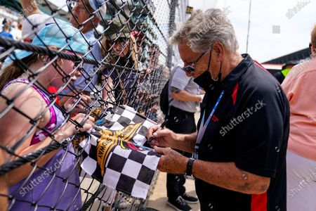 Indianapolis 500 champion Mario Andretti signs autographs for fans during practice for the Indianapolis 500 auto race at Indianapolis Motor Speedway in Indianapolis