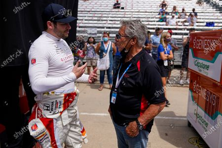 Marco Andretti, left, talks with his grandfather and Indianapolis 500 champion Mario Andretti during practice for the Indianapolis 500 auto race at Indianapolis Motor Speedway in Indianapolis